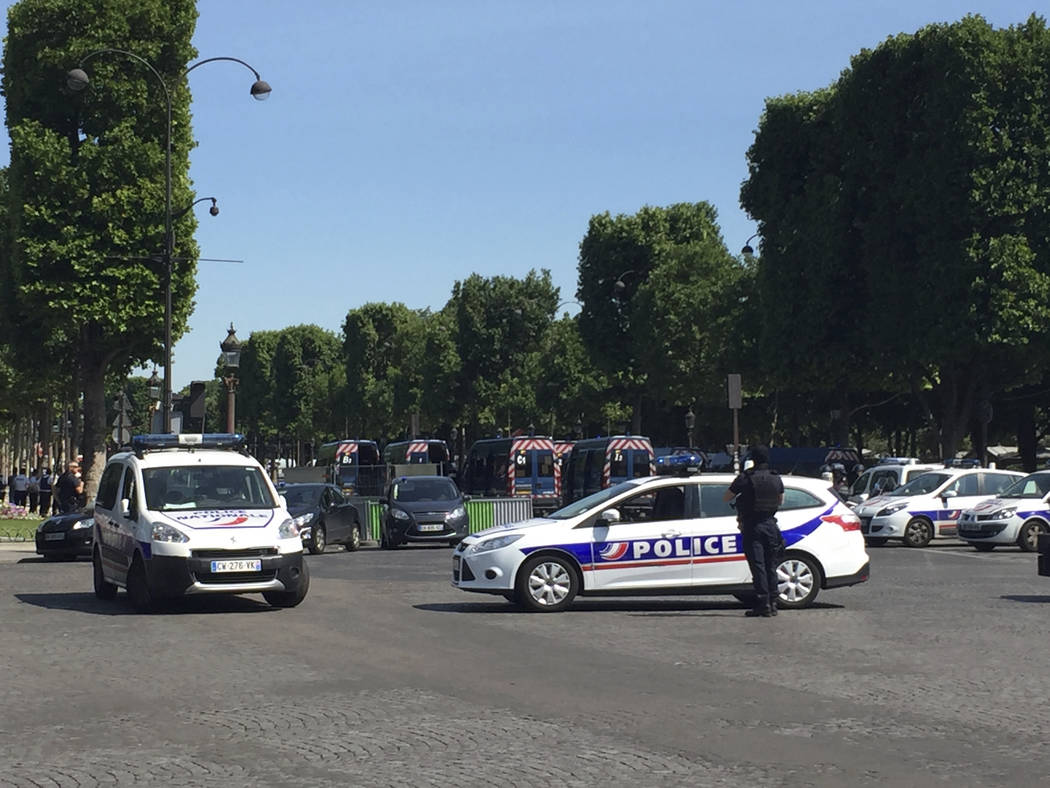 Police vehicles prevent the access to the Champs Elysees avenue in Paris, France, Monday, June 19, 2017. Paris officials say : Suspected attacker 'downed' after driving into police car on Champs-E ...