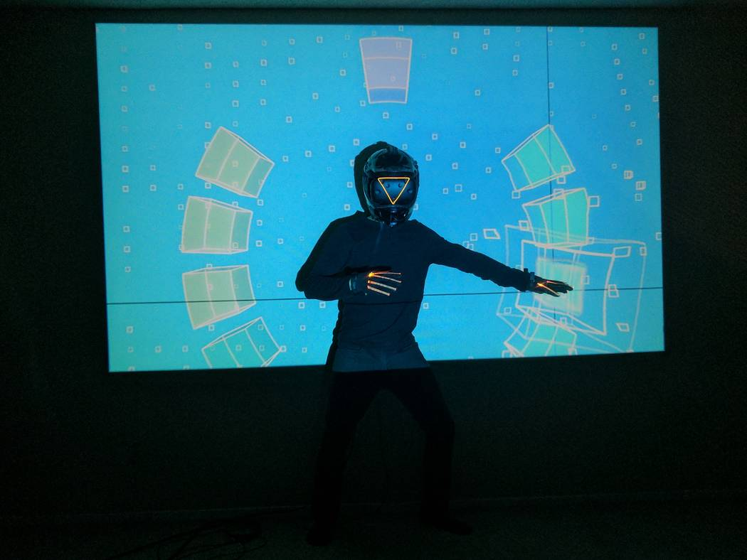 """The """"sound space"""" portrays the music notes, represented by colorful boxes, that Li motions to. When he gestures to a box, a note sounds and the box vibrates on the screen. (Ray Li)"""