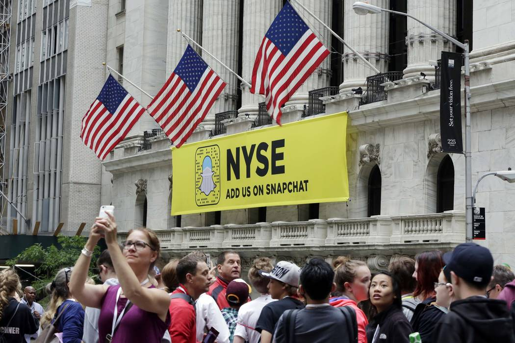 A Snapchat banner hangs on the facade of the New York Stock Exchange, Friday, June 16, 2017. (Richard Drew/AP)