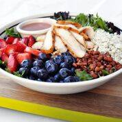 The Berry Pecan Salad is a crisp, refreshing mixed greens salad topped with all natural chicken, fresh strawberries and blueberries, blue cheese crumbles and candied pecans, and served with strawb ...