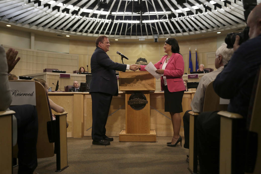 Newly inducted Municipal Court Judge of Department III, Rodney T. Burr, is sworn in by Sabrina Mercadante at Henderson City Hall Council Chambers  in Henderson, Tuesday, June 20, 2017. Gabriella A ...
