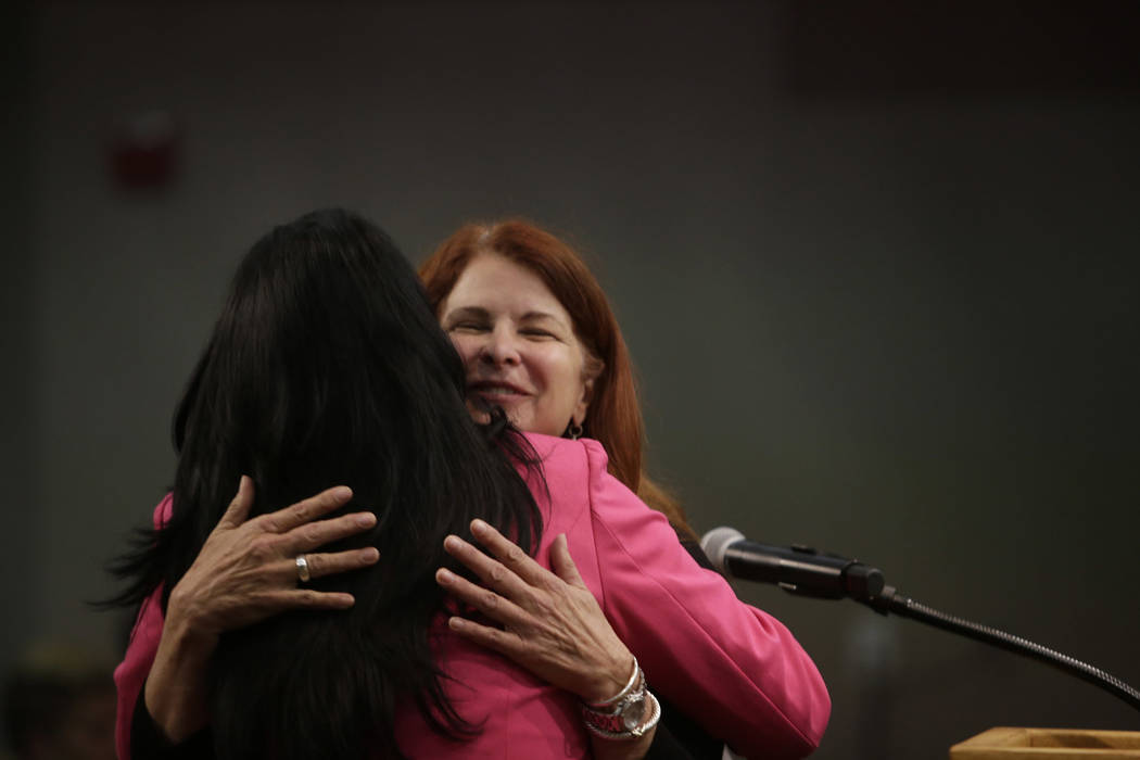 Newly elected Mayor Debra March (center) hugs in by Sabrina Mercadante  after being sworn in at Henderson City Hall Council Chambers in Henderson, Tuesday, June 20, 2017. Gabriella Angotti-Jones L ...