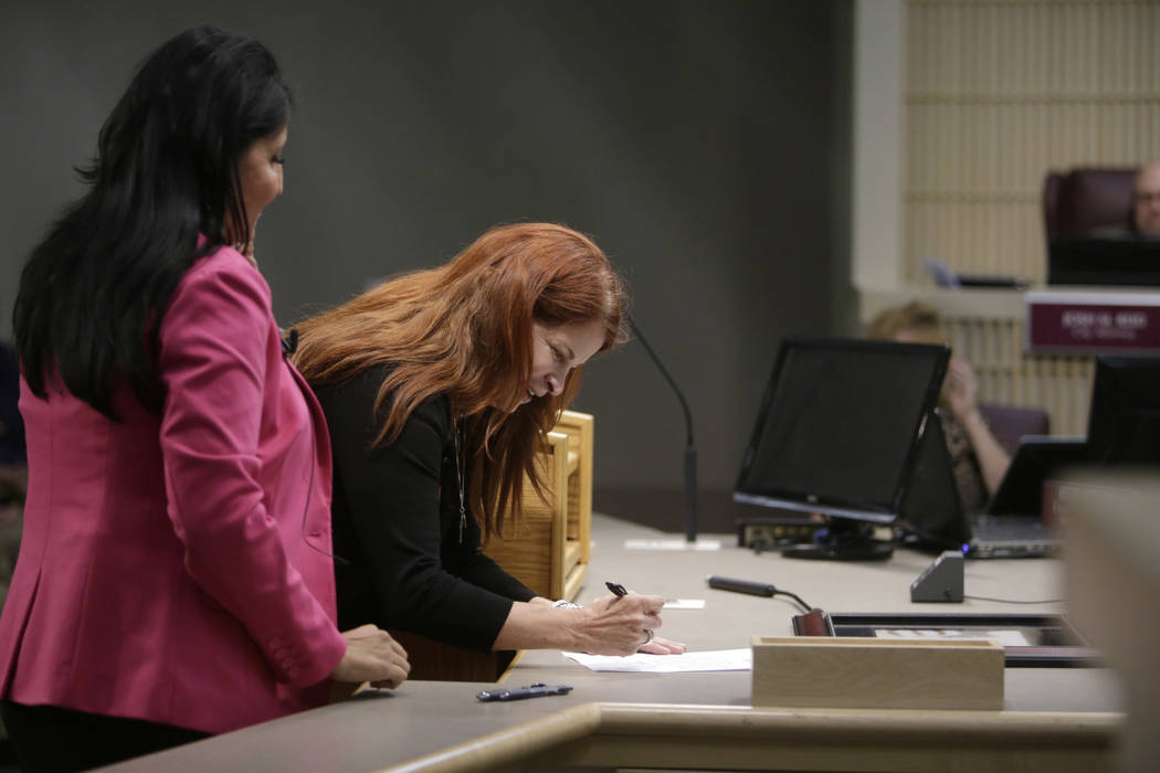 Newly elected Mayor Debra March (center) is sworn in by Sabrina Mercadante (left) at Henderson City Hall Council Chambers in Henderson, Tuesday, June 20, 2017. Gabriella Angotti-Jones Las Vegas Re ...