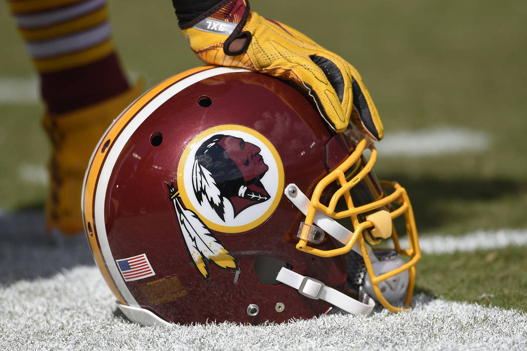 A Washington Redskins helmet on the sidelines during the first half of an NFL football game against the Dallas Cowboys in Landover, Maryland, on Sept. 18, 2016. The Supreme Court on Monday, June 1 ...