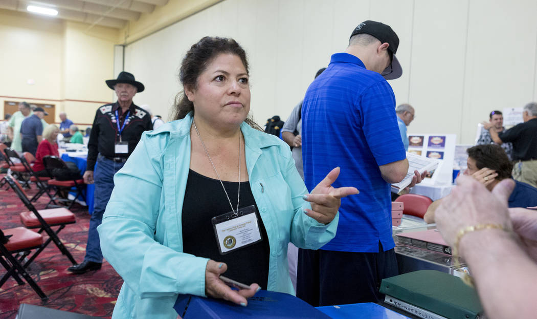 Chip seller Maria Porcayo works during the 25th annual Casino Collectibles Convention at South Point hotel-casino  in Las Vegas, Thursday June 22, 2017. Elizabeth Brumley Las Vegas Review-Journal