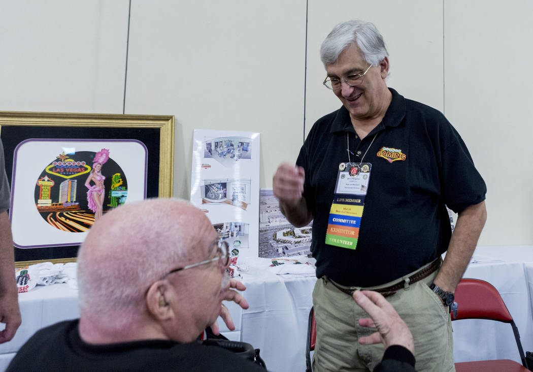 Sheldon Smith convention co-chairperson, left, and Jerry Vergatos, future convention president  talk during the 25th annual Casino Collectibles Convention at South Point hotel-casino  in Las Vegas ...