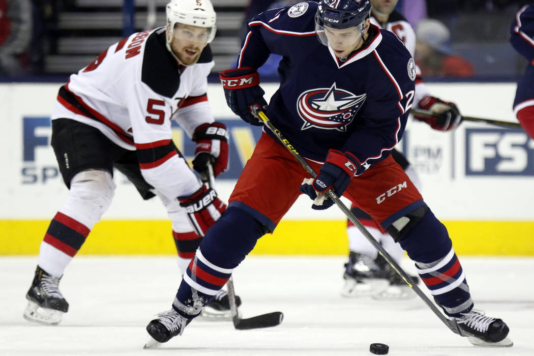 Columbus Blue Jackets' Kerby Rychel, right, works for the puck against New Jersey Devils' Adam Larsson, of Sweden, during an NHL hockey game in Columbus, Ohio,  Thursday, Feb. 25, 2016. The Blue J ...
