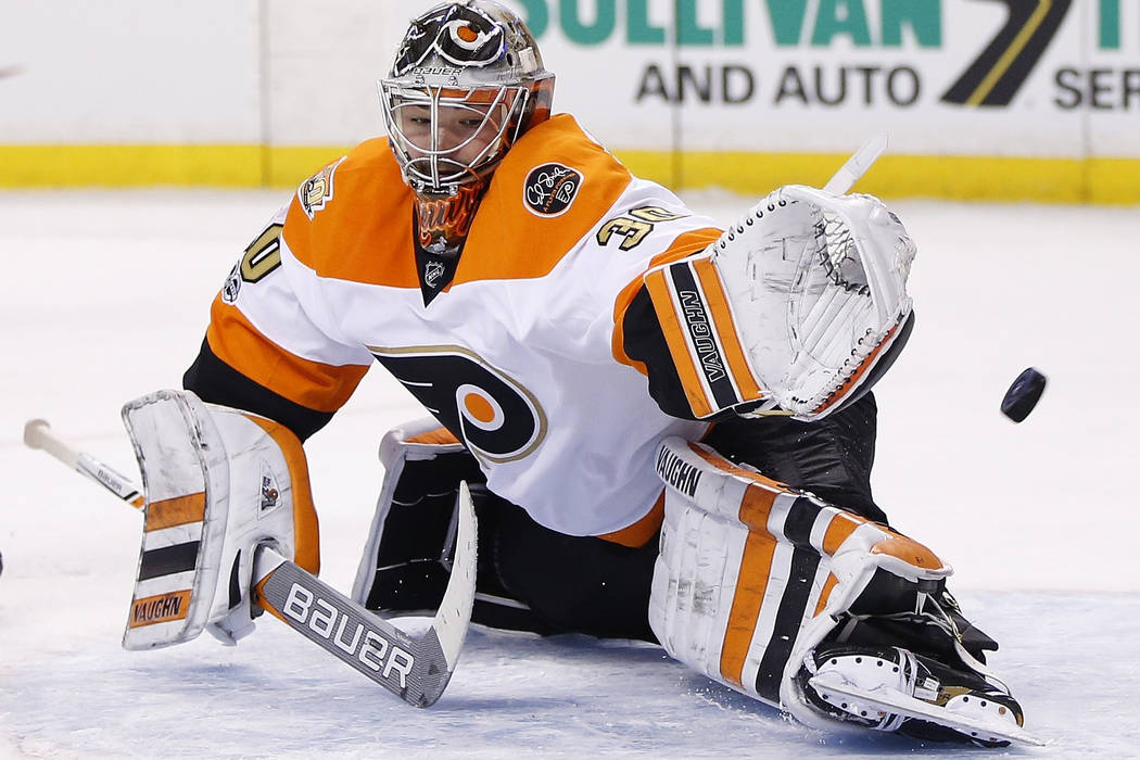 Philadelphia Flyers' Michal Neuvirth, of the Czech Republic, can not stop a shot by Boston Bruins' Zdeno Chara, of Slovakia, during the second period of an NHL hockey game in Boston, Saturday, Jan ...