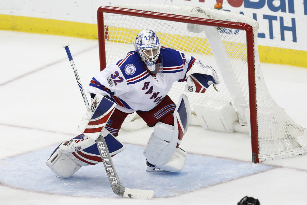 New York Rangers goalie Antti Raanta (32), of Finland, protects his net against the New Jersey Devils during the third period of an NHL hockey game, Tuesday, March 21, 2017, in Newark, N.J. (AP Ph ...