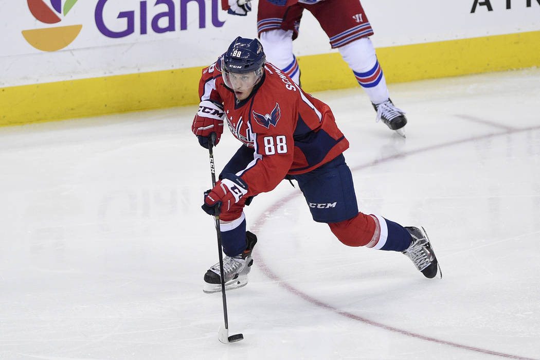 Washington Capitals defenseman Nate Schmidt (88) skates with the puck during the third period of an NHL hockey game against the New York Rangers, Wednesday, April 5, 2017, in Washington. The Capit ...