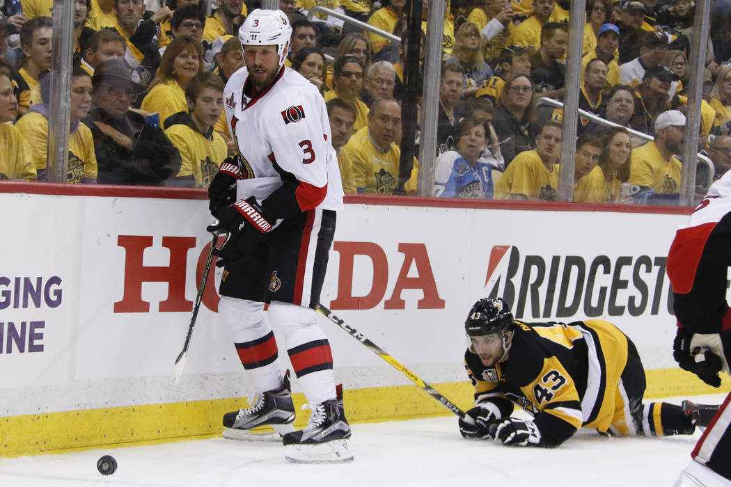 Ottawa Senators' Marc Methot (3) and Pittsburgh Penguins' Conor Sheary (43) pursue the puck during the second period of Game 1 of the Eastern Conference final in the NHL hockey Stanley Cup playoff ...