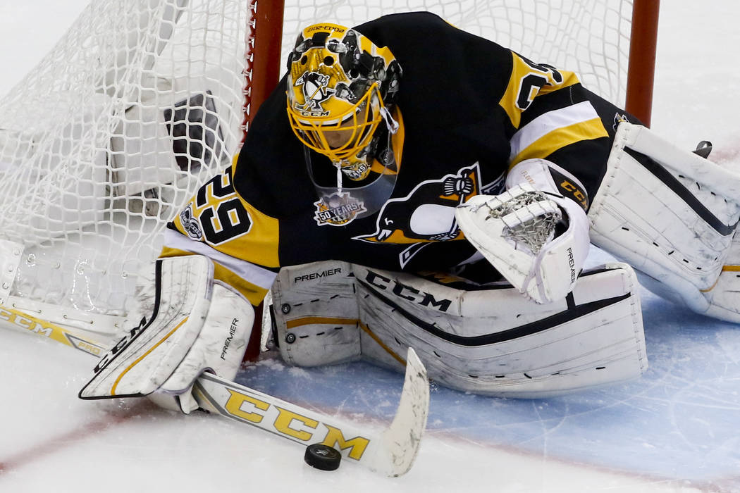 Pittsburgh Penguins goalie Marc-Andre Fleury blocks the puck during the first period of Game 2 of the Eastern Conference final against the Ottawa Senators in the NHL Stanley Cup hockey playoffs in ...