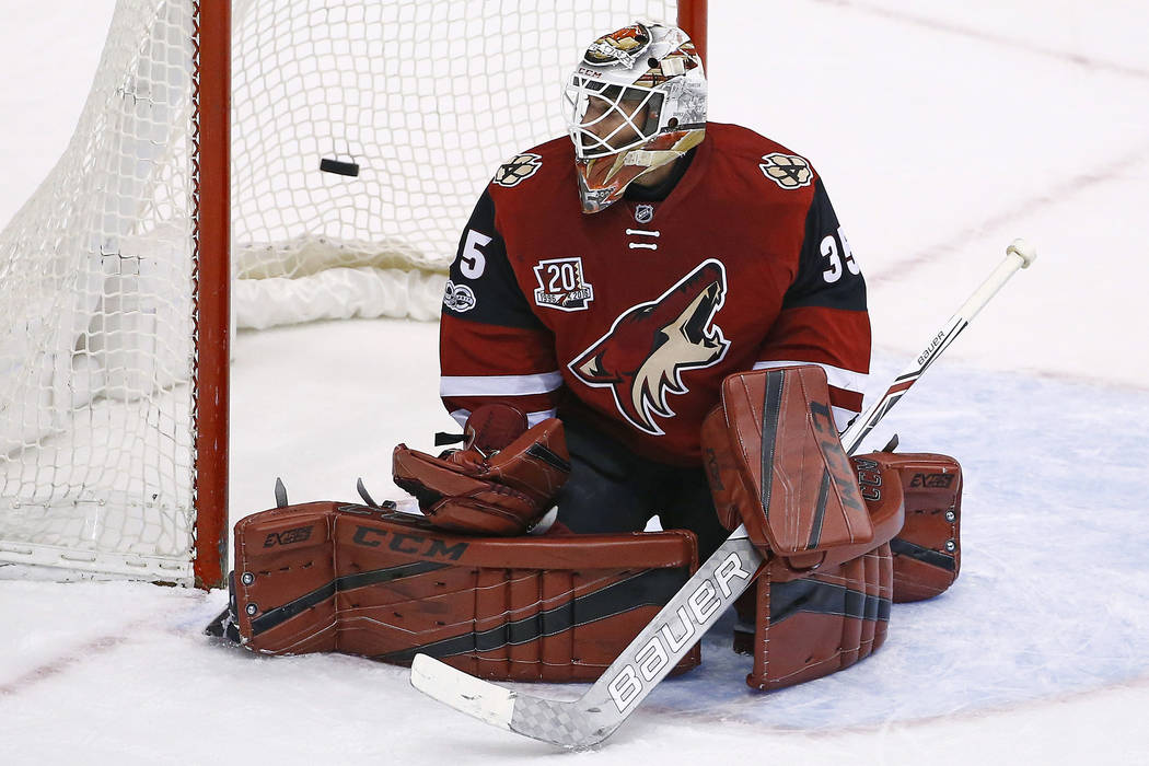 Arizona Coyotes' Louis Domingue gives up a goal to Vancouver Canucks' Daniel Sedin during the third period of an NHL hockey game Thursday, April 6, 2017, in Glendale, Ariz.  The Coyotes defeated t ...