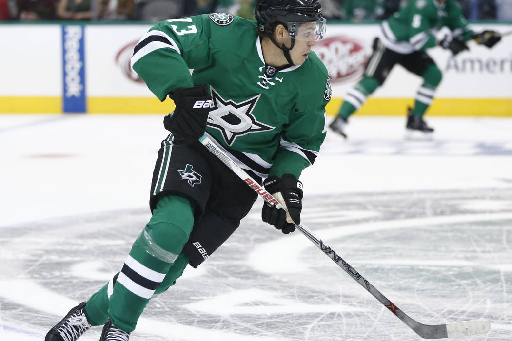 Dallas Stars center Mattias Janmark skates the puck up ice against the St. Louis Blues during the first period of an NHL hockey game, Monday, Sept. 26, 2016, in Dallas.  (AP Photo/Jim Cowsert)