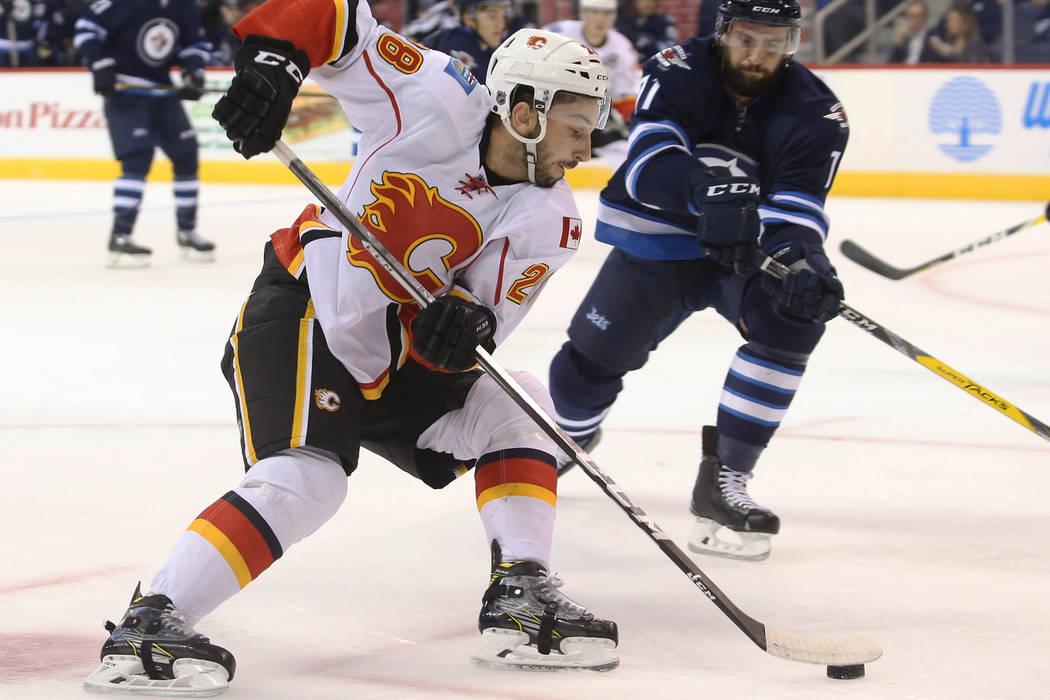 Sep 27, 2016; Winnipeg, Manitoba, CAN; Winnipeg Jets defenceman Julian Melchiori (71) looks to challenge Calgary Flames forward Emile Poirier (28) during the first period during preseason hockey g ...