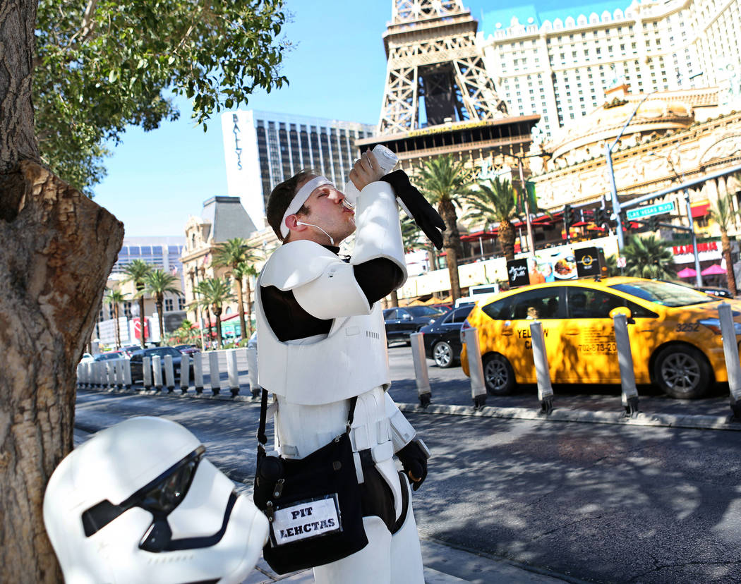 Adam Reynolds a street performer hydrates in 113 degree weather by the Bellagio fountains in Las Vegas, Monday, June 19, 2017. Elizabeth Brumley the Las Vegas Review-Journal