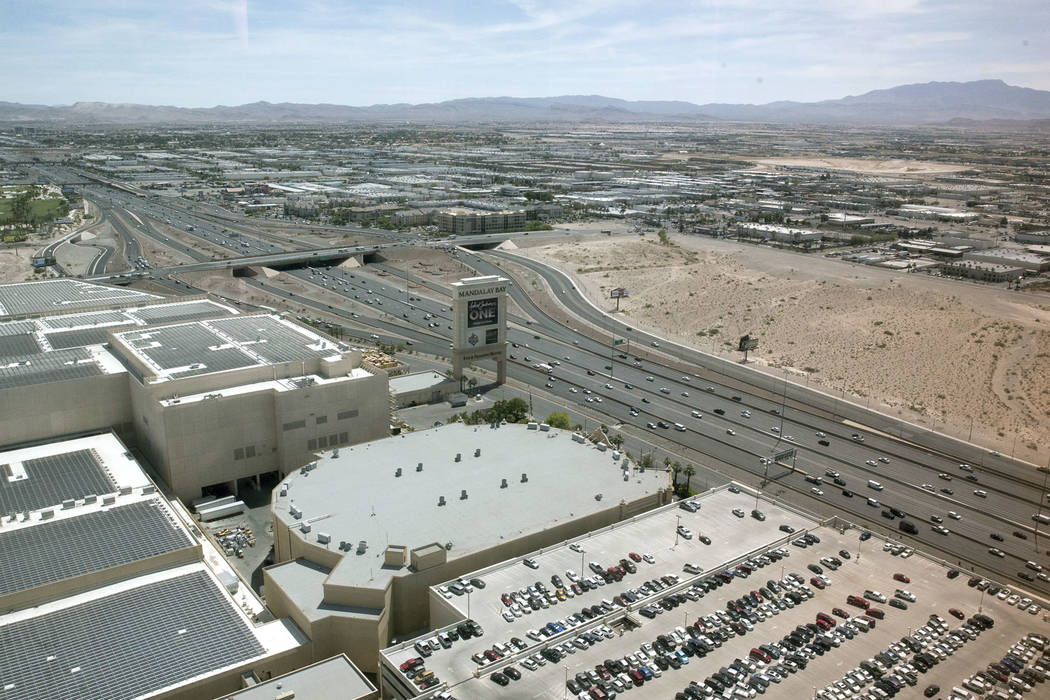 The proposed site for the Raiders football stadium, right, near Interstate 15 and Russell Road, in Las Vegas on Wednesday, June 7, 2017. Mandalay Bay is to the left of the site. (Erik Verduzco/Las ...