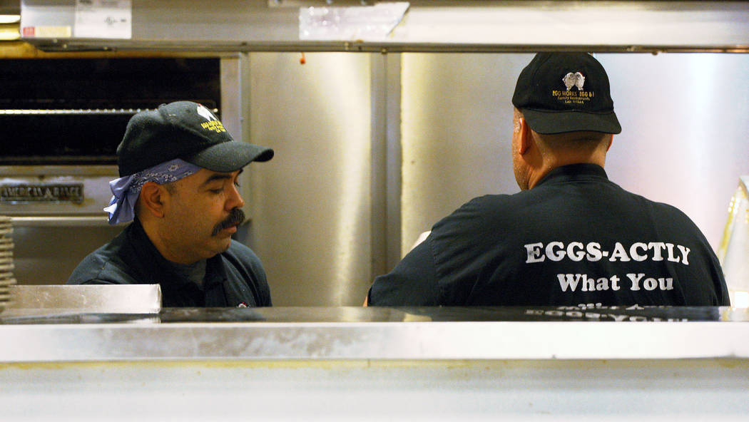Egg Works employees Nicholas Muñoz, left, and Octavio Tovar prepare breakfast orders for customers, Tuesday, June 20, 2017. Gabriella Benavidez Las Vegas Review-Journal @latina_ish