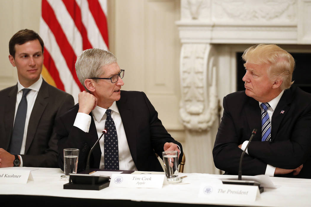 Tim Cook, Chief Executive Officer of Apple, speaks as President Donald Trump, right, and Jared Kushner, White House Senior Adviser, left, listen during an American Technology Council roundtable in ...