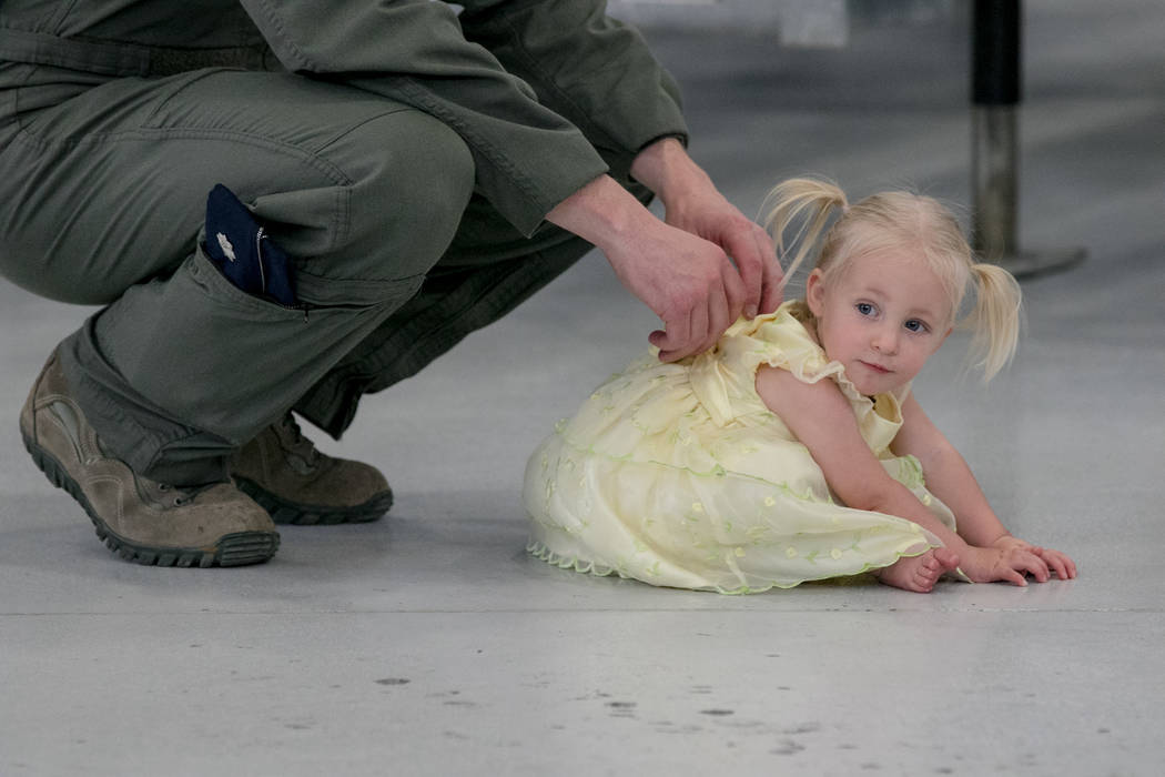 Peter Schnobrick holds his daughter Amelia, 15 months, at Nellis Air Force Base during an activation ceremony of an F-35A Lightning II aircraft on Tuesday, June 21, 2017, in Las Vegas. Morgan Lieb ...