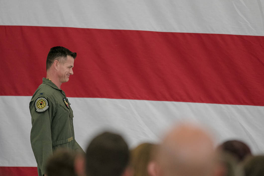 Col. Michael R. Drowley leaves the hangar podium at Nellis Air Force Base during an activation ceremony of an F-35A Lightning II aircraft on Tuesday, June 21, 2017, in Las Vegas. Morgan Lieberman  ...
