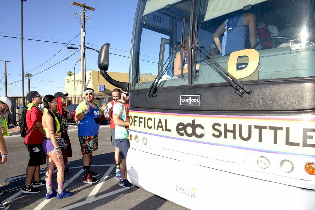 LVCVA Host Committee Brand Ambassador Showgirls giving away cooling towels and bracelets to Electric Daisy Carnival fans waiting in line for the downtown shuttles to Day 1 of the EDC event at the  ...