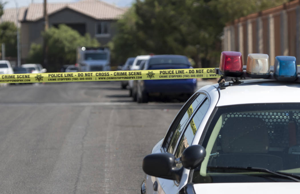Las Vegas police cordon off roads near West Charleston Road and South Cimarron Road on Tuesday, June 20, 2017. Police shot and killed a man early Tuesday morning inside an apartment at 1111 S. Cim ...