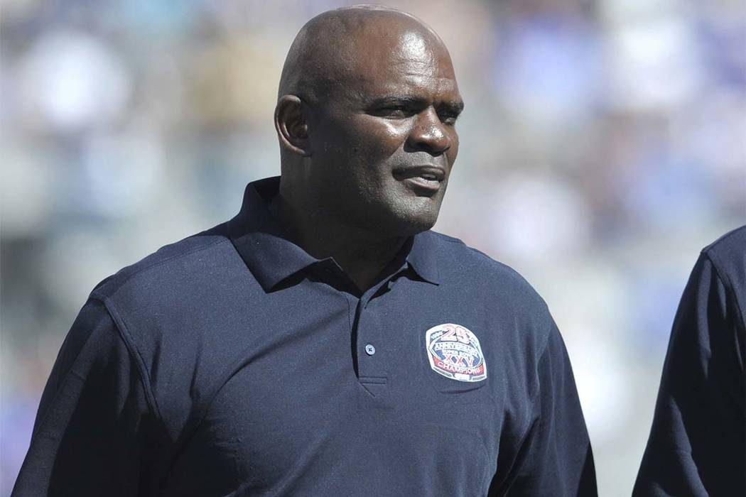 In this Sept. 20, 2015, photo, former New York Giants' Lawrence Taylor looks on during a 25 year anniversary celebration at halftime of an NFL football game against the Atlanta Falcons in East Rut ...