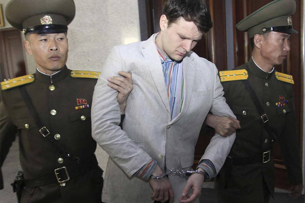 In this March 16, 2016, file photo, American student Otto Warmbier, center, is escorted at the Supreme Court in Pyongyang, North Korea. Warmbier, an American college student who was released by No ...