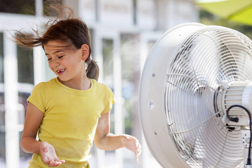 Adrianna Kostrzewa, 7, of Santa Barbra, Calif., cools off with misters on the Strip in Las Vegas as the temperature reached 116 on Tuesday, June 20, 2017.  Patrick Connolly Las Vegas Review-Journa ...