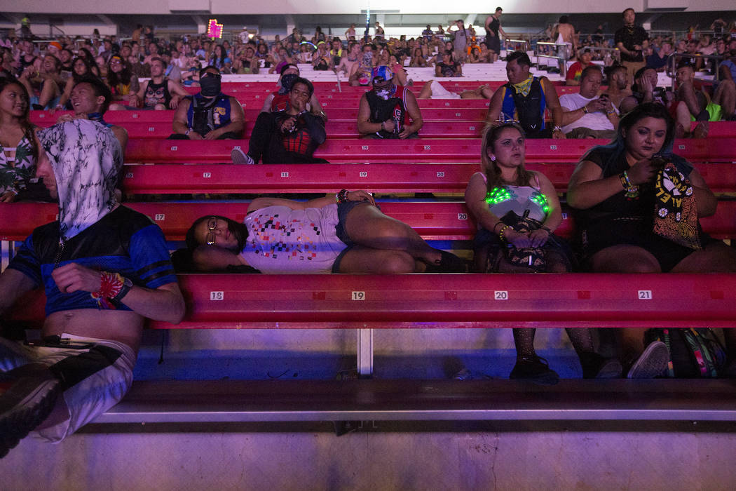 A woman rests in the stands during Rfs Du Sol's performance at Cosmic Meadow on the second night of Electric Daisy Carnival at Las Vegas Motor Speedway on Sunday, June 18, 2017 in Las Vegas. (Brid ...