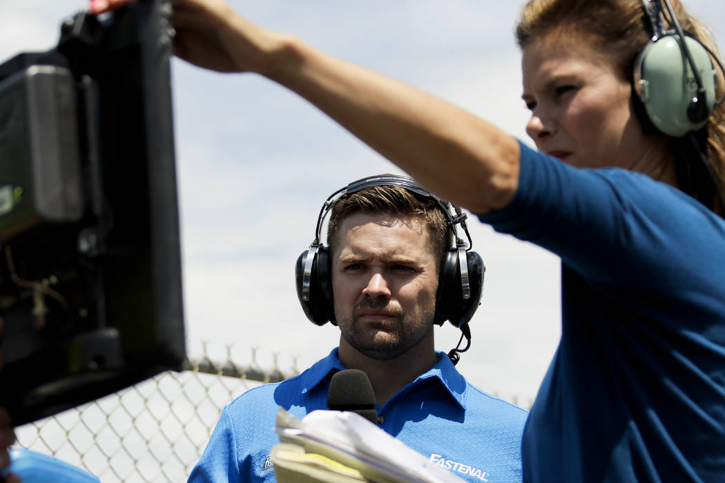 Driver Ricky Stenhouse Jr., left, and broadcast pit reporter Jamie Little look over a monitor during the NASCAR xfinity Series auto race, Saturday, June 10, 2017, in Long Pond, Pa. (AP Photo/Matt  ...