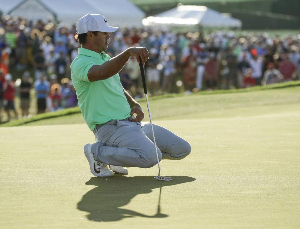 Brooks Koepka waits to putt on the 18th hole during the fourth round of the U.S. Open golf tournament Sunday, June 18, 2017, at Erin Hills in Erin, Wis. (AP Photo/Charlie Riedel)