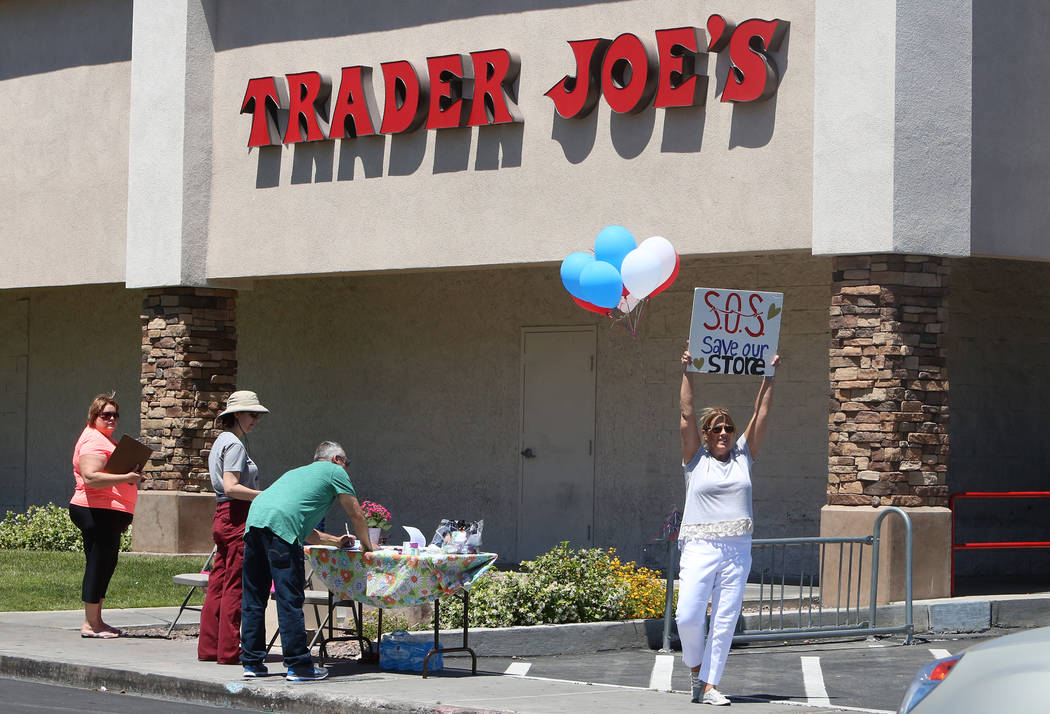 Jan Callister, right, protests the planned move of the Decatur Boulevard Trader Joe's on Monday, May 1, 2017. (Bizuayehu Tesfaye Las Vegas-Review Journal) @bizutesfaye