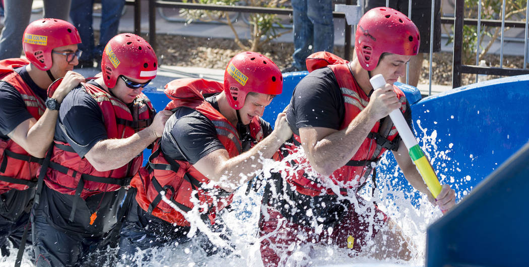 Firefightes during a simulation of a rescue in the wash and churning water conditions at Wet'n'Wild Las Vegas in Las Vegas, Wednesday, June 21, 2017. Elizabeth Brumley Las Vegas Review-Journal