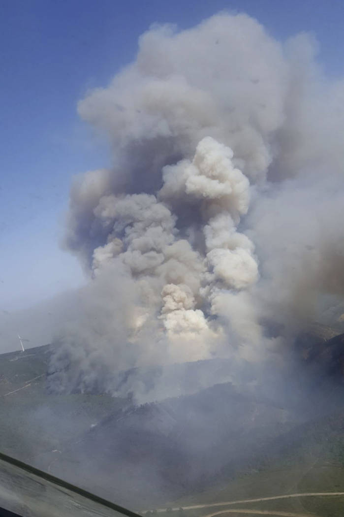 In this image made available by the Spanish Airforce on Tuesday June 20, 2017, a Spanish firefighting plane flies over the fires in the Pedrogao Grande area, Portugal. (Spanish Airforce via AP)
