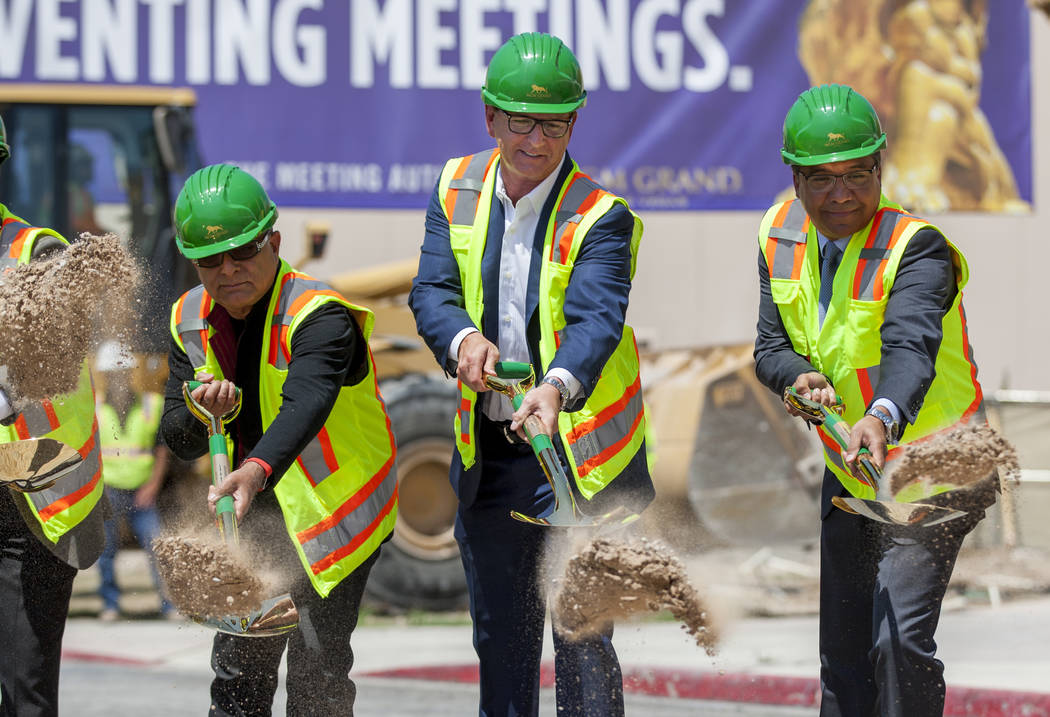 Deepak Chopra, an alternative medicine advocate, from left, Scott Sibella, president and COO of the MGM Grand, and Michael Dominguez, senior vice president and chief sales officer, shovel dirt at  ...