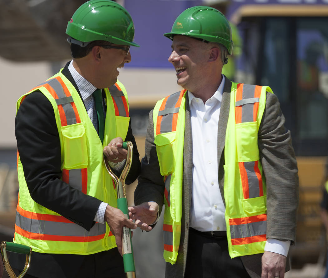 Ernest Stovall, vice president of sales at MGM Grand, left, and Michael Brenner of Pegasystems share a moment during the groundbreaking of the MGM Grand Convention Center expansion project on Tues ...