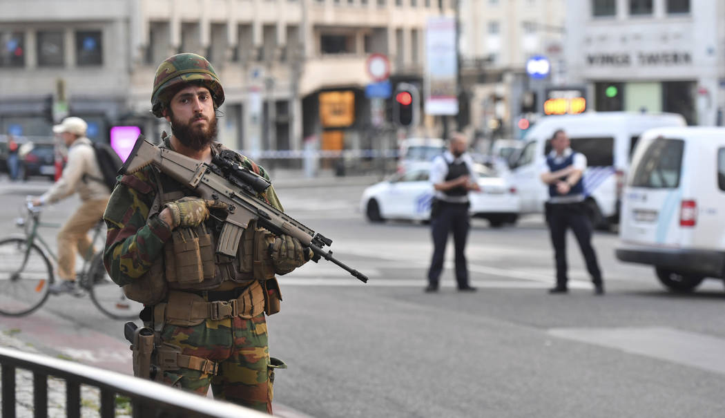 A Belgian Army soldier stands outside Central Station after a reported explosion in Brussels on Tuesday, June 20, 2017. Belgian media are reporting that explosion-like noises have been heard at a  ...
