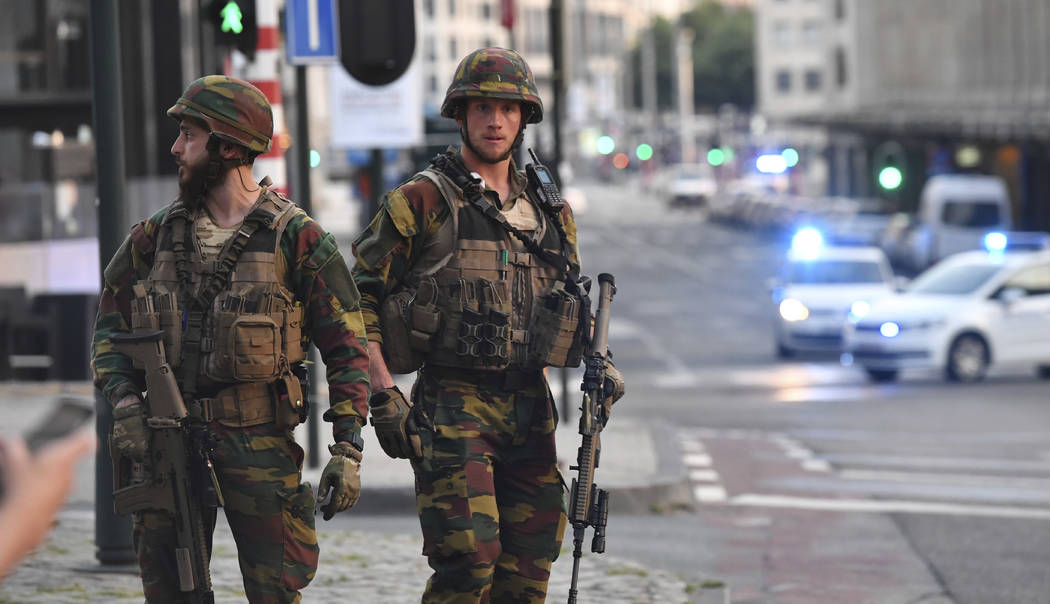 Belgian Army soldiers patrol outside Central Station after a reported explosion in Brussels on Tuesday, June 20, 2017. Belgian media are reporting that explosion-like noises have been heard at a B ...