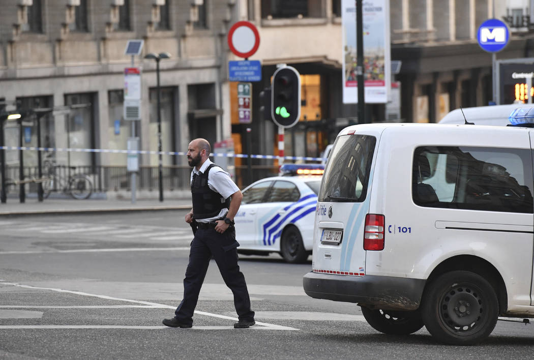 A police officer walks outside Central Station after a reported explosion in Brussels on Tuesday, June 20, 2017. Belgian media are reporting that explosion-like noises have been heard at a Brussel ...