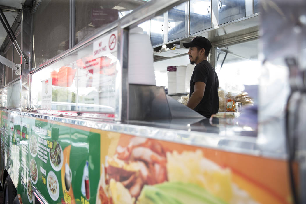 Oswaldo Hernandez, a cook at El Buen Pastor taco truck in Las Vegas, prepares food inside the food truck which temperatures can reach 130 degrees in the summer, on Tuesday, June 20, 2017. Erik Ver ...