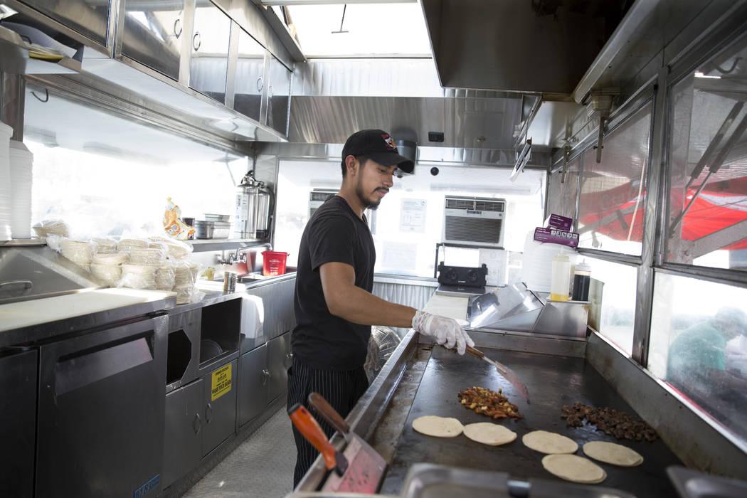 Oswaldo Hernandez A Cook At El Buen Pastor Taco Truck In Las Vegas Prepares