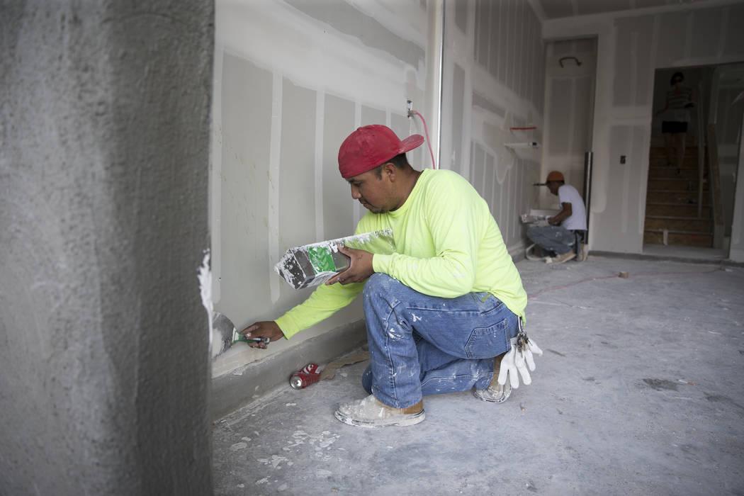 Drywall finisher Carlos Garcia works inside a North Las Vegas home on Tuesday, June 20, 2017. Erik Verduzco/Las Vegas Review-Journal