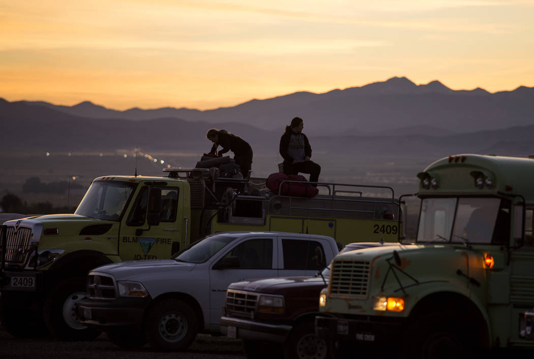 From left, Twin Falls, Idaho, firefighters Tenli Bright and Kori Neiwirth get ready to roll out for the day on the fire line, Parawan, Utah, Monday, June 19, 2017. Utah firefighters were battling  ...