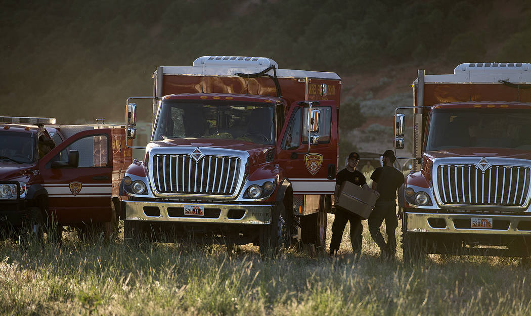 Firefighting crews get ready to roll out for the day on the fire line, Monday, June 19, 2017, to put out a wildfire burning north of the southern Utah ski town of Brian Head, Utah. (Leah Hogsten/T ...