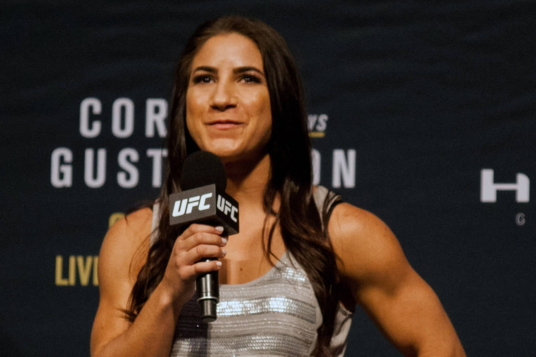 UFC strawweight fighter Tecia Torres takes questions from fans during a UFC 192 press conference in Houston, Friday, Oct. 2, 2015. (AP Photo/Juan DeLeon)