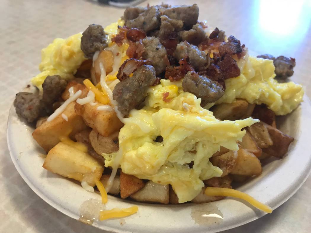 Potato scramble comes with seasoned potatoes, sausage, bacon, egg and jack and cheddar cheese at Waffles Cafe, 6885 N. Aliante Pkwy #103. (Kailyn Brown/View) @KailynHype