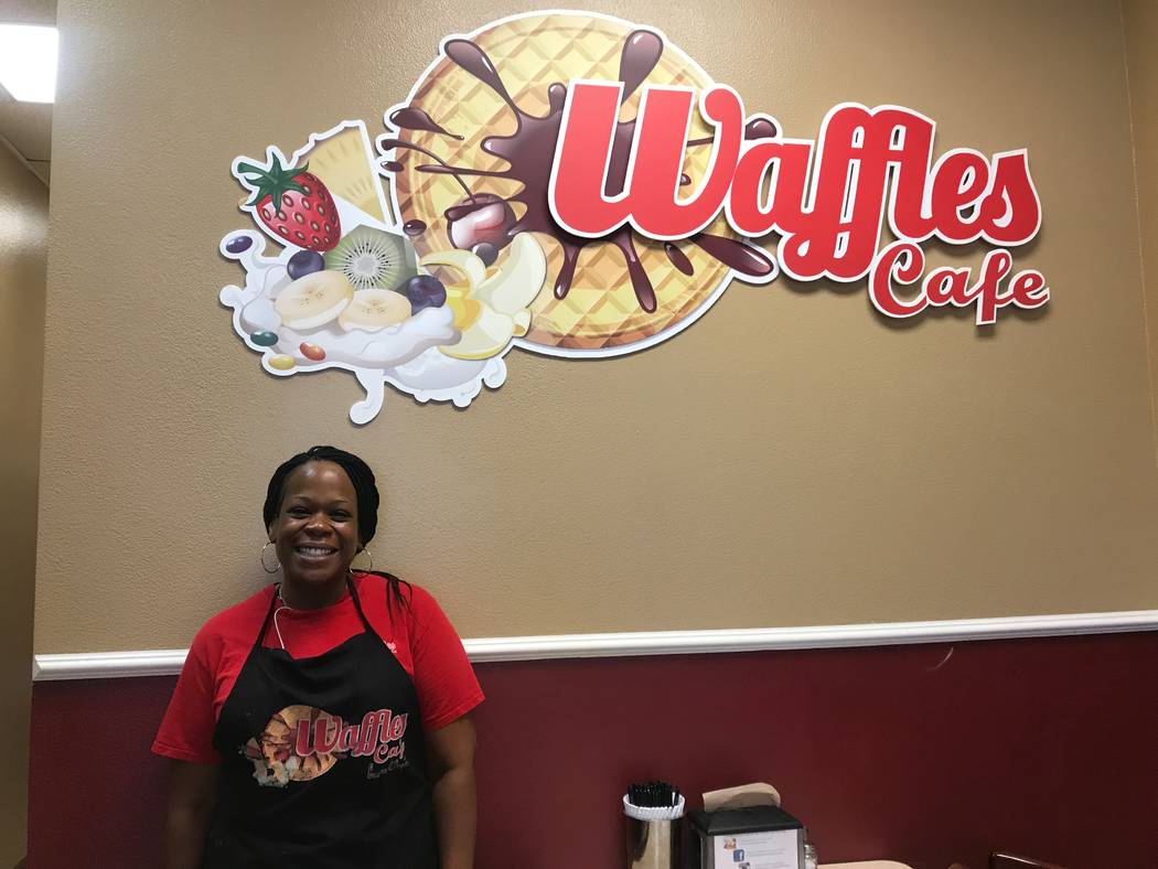 Co-owner Kimberly Brown stands by sign June 20 at Waffles Cafe, 6885 N. Aliante Pkwy #103. (Kailyn Brown/View) @KailynHype