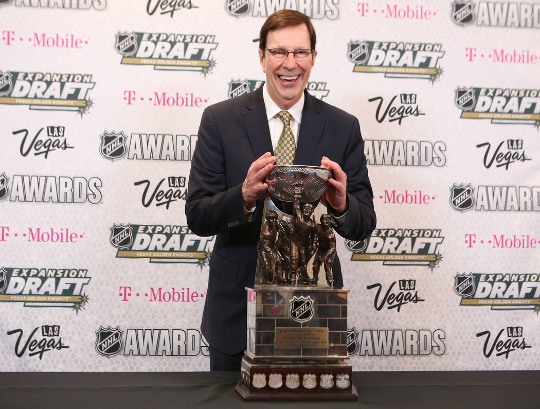 John Tortorella of the Columbus Blue Jackets is pictured with the Jack Adams Award that was awarded to him at the 2017 NHL Awards at T-Mobile Arena on Wednesday, June 21, 2017 in Las Vegas. Bridge ...